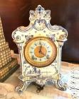 "Royal Bonn 'Delft' china-case clock with Ansonia movement, antique, with key & pendulum. 11""high. Excellent condition."