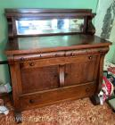 "Oak buffet with mirrored back, 46""wide, good original cond."