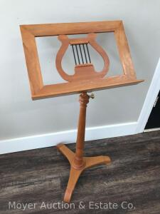 "Wood Music Stand, adjustable height, 18""wide, appears to be a light cherry"