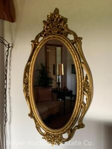"Oval Wall Mirror, molded gold plastic frame, 29""h x 17""w"