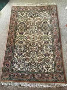"Oriental Carpet, hand-knotted, green & rust colors, good condition, 72""l x 46""w"
