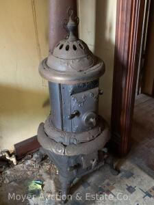 "Peninsular Stove Co. ""114 Oak"" round heating stove with finial, good condition, 47""h to finial"