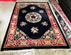 "Chinese Oriental Rug, black with red border, 66"" x 100"", good condition & clean with minor fringe discolored"
