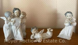 "3 Lladro 'angel' figures, tallest is 7"" group of 3 singing, angel playing flute, & angel on ground; all good condition"