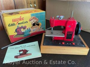 "Battery Operated Toy Sewing Machine ""little modiste"", w/box & instruction book"