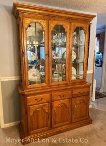 "Oak China Cabinet by Sumpter Cabinet Co., lighted with mirrored back & glass shelves, exc. condition, 2pc., 55""wide"