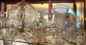 Group of Fine Clear Glass in China Cabinet incl. cut vase, 2 pr. candleholders, serving pcs., many Candlewick pcs. incl. cr.&sugar, lg. pitcher, butte