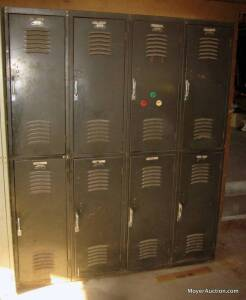 Section of 8 metal lockers (one piece), some have shelves, 5ft. wide x 6ft. tall x 16in. deep