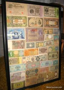 Collection of vintage foreign currency, framed, 30in. tall x 22in. wide, paper money from countries incl. Germany, Italy, France, Japan, etc.
