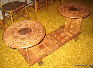 Carved coffee table with brass inlay, 48in. wide, round tops are 17in. wide, piece is on wheels, nice condition