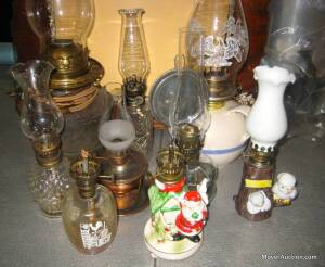 Group of assorted oil lamps incl. miniatures, & pr. of iron candleholders,