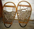 Pr. of wooden snowshoes, oval or egg shaped, taped on bottom