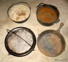 "Group with cast iron skillet, early iron griddle w/handles- 10""x20"", alum. griddle, & 2 pots (bid is for all 5)"