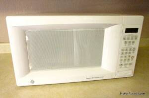 "GE microwave, digital model #JES1451DNIWW, white, 22"" wide by 16"" deep, good condition"