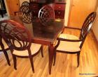 "Bombay Co. dining table & 6 chairs, made in Italy, table has glass protective top & is 5ft. 6In. long by 36"" wide plus a large 24"" leaf to make it even longer.  6 chairs with tan upholst. seats - one of the chairs is a captains chair w/arms.  All in very"