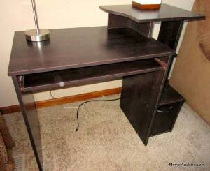 "Sauder black computer desk, keyboard pull-out shelf, small door at bottom, laminate construction, top is 39""wide by 20""deep."