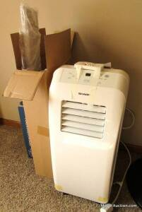 Sharp portable air conditioner, floor-type, model #CV-10CTX-W, with remote, manual & duct, practically-new, (only used but a couple times).