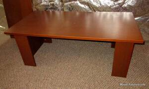 "Coffee table, laminate construction, with lower shelf, overall top is 46""long by 24""wide, 18""tall, sturdy but top has some wear. (pic. shows without lower shelf)"
