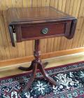 Mahogany drop-leaf stand with leather inlay top