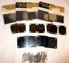 GROUP OF 13 FENDER NECK PLATES