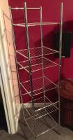 Narrow metal shelf