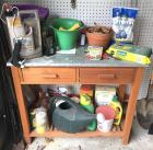Potting Bench with assorted gardening supplies
