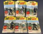 Group of 6 1965 James Bond Action Figures by Gilbert on cards and 3 paperback books