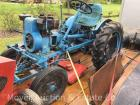 1954 Economy Garden Tractor, with blade, serial #3695, B&S engine 23FB, rolls ok, steering poor, tires poor from sitting
