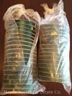 "33 rolls of 5/8"" satin Hunter Green polyester ribbon, 100yd. rolls, some may have been started"