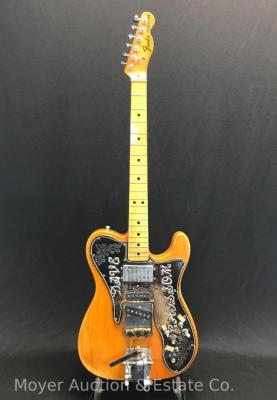 Fender Telecaster Electric Guitar, original, unique leather pick guard, serial #418823, pickup plate 'Fender A024005', dates between April 1973 & Sept. '76, 5 Grover tuners & 1 Fender tuner, hard shell case. Normal cracks in clear on back.